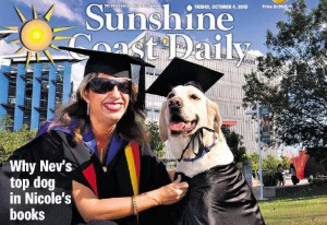 DGHA member Nicole Damarra and Guide Dog Nev, both in academic robes, at Nicole's Graduation 2013