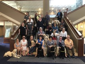 Image of attendees and their dogs at the DGHA 2018 National Conference in the Novotel Brighton Beach lobby